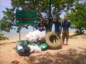 Carlos assisting Eileen Alicea of NOAA and Robert Matos of DRNA in beach cleanup, Seven Seas